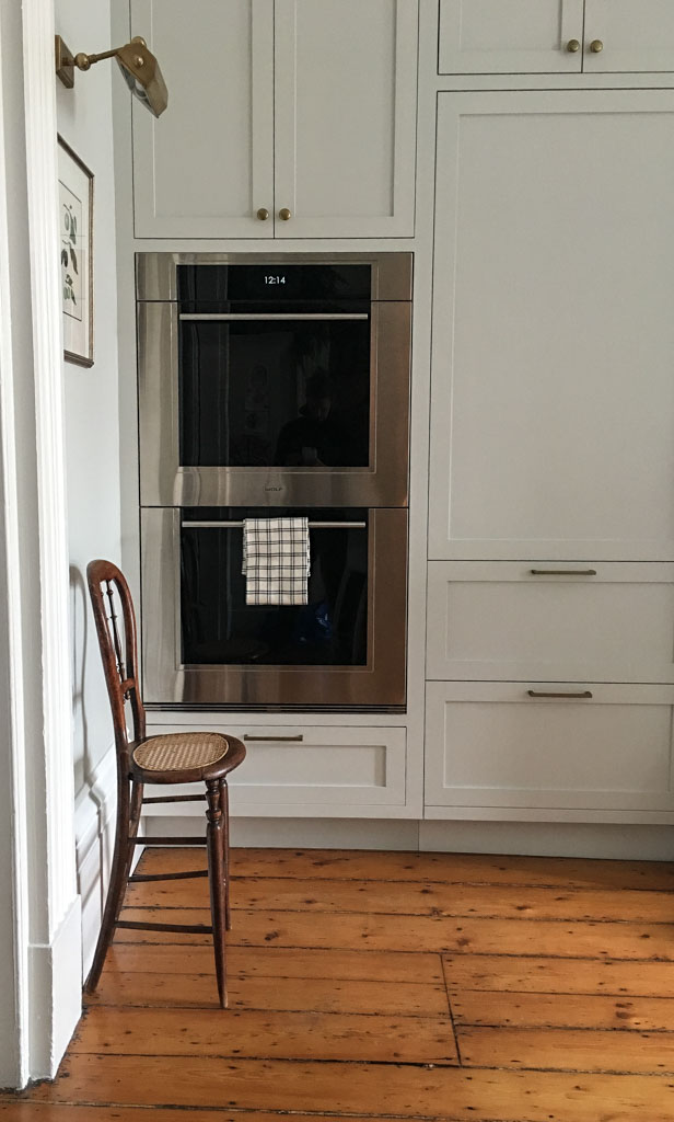 tea towel on oven door