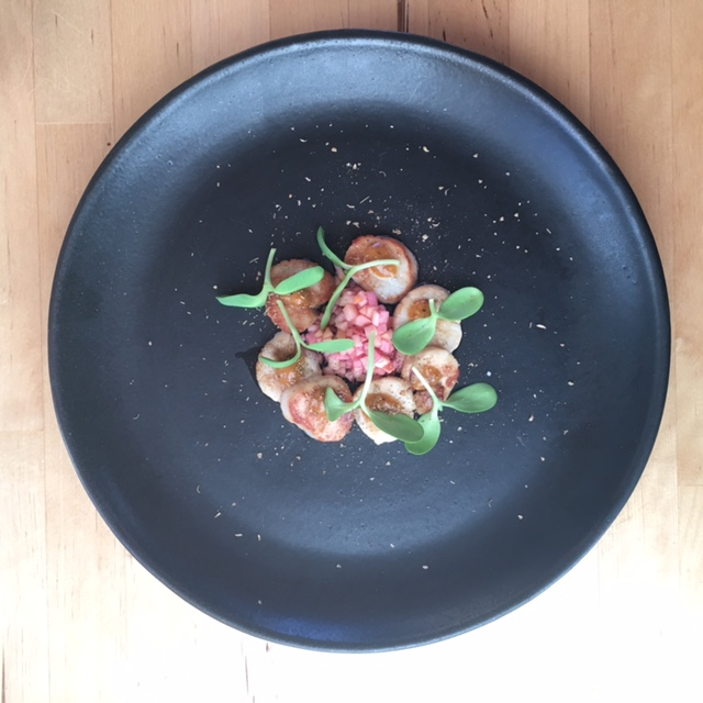 Black Plate, Scallops, Pink Apple, sunflower sprouts
